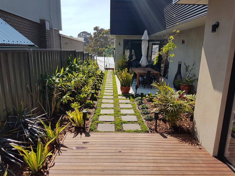 Decking, grass paving and entry statement plantings