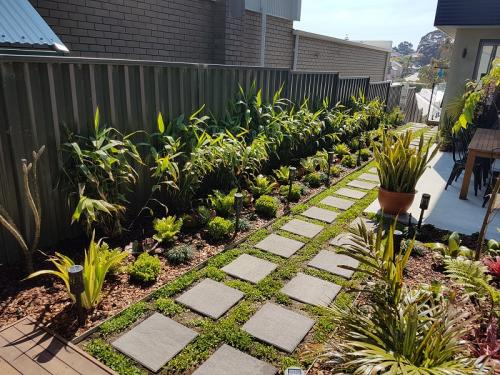 Grass Paving blockwork and tropical screening plants