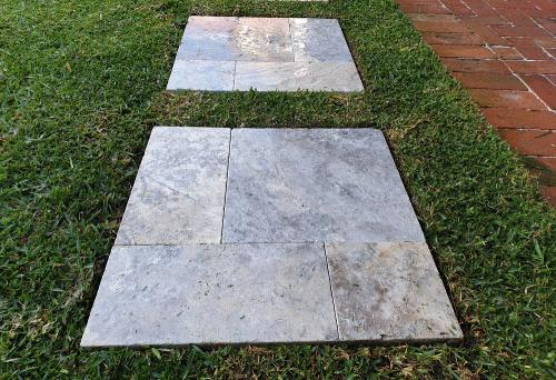 Precision lawn mowing with edging around pavers